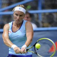 Photo - Svetlana Kuznetsova, of Russia, returns the ball against Polona Hercog, of Slovenia, during a match in the Citi Open tennis tournament, Monday, July 28, 2014, in Washington. (AP Photo/Nick Wass)