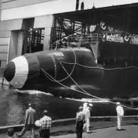 Photo - FILE- In this July 9, 1960 handout file photo provided by the U.S. Navy, the nuclear-powered submarine USS Thresher is launched at the Portsmouth Naval Shipyard in Kittery, Maine. Fifty years ago 129 men lost their lives when the sub sank during deep-dive testing off Cape Cod. The deadliest submarine disaster in U.S. history delivered a blow to national pride during the Cold War and became the impetus for safety improvements. (AP Photo/U.S. Navy, file)