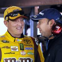 Photo - NASCAR Sprint Cup driver Kyle Busch, left, talks with Chad Knaus, prior to practice at Martinsville Speedway in Martinsville, Va., Friday March 28, 2014. (AP Photo/Mike McCarn)