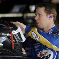 Photo -   FILE - In this Sept. 28, 2012, file photo, Driver Brad Keselowski prepares his helmet before practice for the NASCAR Sprint Cup Series auto race in Dover, Del. There's debate over where a driver wants to be in the championship standings at this point of the Chase for the Sprint Cup. Keselowski is quite comfortable in the lead. (AP Photo/Nick Wass File)