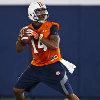 Photo - Auburn quarterback Nick Marshall sets to throw during NCAA college football practice Friday, Aug. 1, 2014, in Auburn, Ala. (AP Photo/Brynn Anderson)