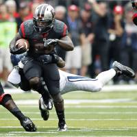 Photo -   Rutgers running back Jawan Jamison drags a Connecticut defender along as he gains yardage during the second half of an NCAA college football game in Piscataway, N.J., Saturday, Oct. 6, 2012. Rutgers won 19-3. (AP Photo/Mel Evans)