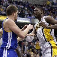 Photo - Indiana Pacers center Roy Hibbert, right, skirmishes with Golden State Warriors forward David Lee during the second half of an NBA basketball game in Indianapolis, Tuesday, Feb. 26, 2013. Lee received a technical foul; Hibbert received two technical fouls and was ejected from the game. The Pacers won 108-97. (AP Photo/AJ Mast)