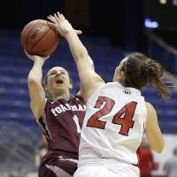 Photo - Fordham guard Erin Rooney (1) shoots as Dayton guard Andrea Hoover (24) defends during the first half of the Atlantic 10 Conference college basketball championship game in Richmond, Va., Sunday, March 9, 2014. (AP Photo/Steve Helber)