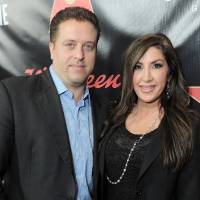 Photo - FILE - This Nov. 30, 2012 file photo originally released by Walgreens shows Chris Laurita, left, and his wife Jacqueline Laurita, of