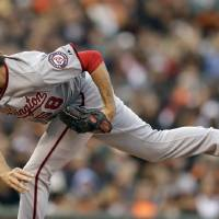 Photo - Washington Nationals' Doug Fister works against the San Francisco Giants in the first inning of a baseball game Tuesday, June 10, 2014, in San Francisco. (AP Photo/Ben Margot)