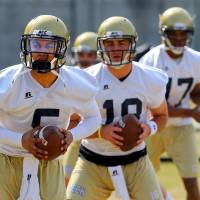 Photo - Georgia Tech quarterbacks, from left,  Justin Thomas, the probable starter, Tim Byely, and Ty Griffin run through drills on the first day of spring football practice at Georgia Tech on Monday, March 24, 2014, in Atlanta.  (AP Photo/Atlanta Journal-Constitution, Curtis Compton)  MARIETTA DAILY OUT; GWINNETT DAILY POST OUT; LOCAL TV OUT; WXIA-TV OUT; WGCL-TV OUT