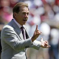 Photo - Alabama coach Nick Saban signals a fourth and 1 during Alabama's A-Day NCAA college football spring game Saturday, April 19, 2014, in Tuscaloosa, Ala. (AP Photo/Butch Dill)