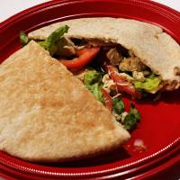 Photo -  Caesar chicken in a pita pocket will be a people-pleaser at your next picnic. Photo by Jim Beckel, The Oklahoman   Jim Beckel
