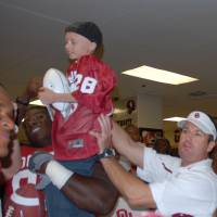 Photo - Turner Swink celebrates his 10th birthday with the Sooners inside the locker room, joining the squad for a full day as part of a Special Spectators event. Special Spectators puts seriously children up close for game day experiences across the country. - PHOTO PROVIDED