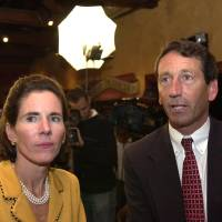 Photo - FILE - South Carolina Republican gubernatorial candidate Mark Sanford, and his wife, Jenny, watch returns at an election-night party in this Nov. 5, 2002 file photo taken at a restaurant in Mount Pleasant, S.C. Former South Carolina Gov. Mark Sanford must appear in court two days after running for a vacant congressional seat to answer a complaint that he trespassed at his ex-wife's home, according to court documents acquired by The Associated Press on Tuesday April 16, 2013. (AP Photo/Lou Krasky, File)