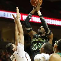 Photo - Baylor's Cory Jefferson shoots over Texas Tech's Dejan Kravic (11) during an NCAA college basketball game in Lubbock, Texas, Wednesday, Jan, 15, 2014. (AP Photo/Lubbock Avalanche-Journal, Tori Eichberger) ALL LOCAL TV OUT