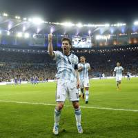 Photo - Argentina's Lionel Messi celebrates scoring his side's second goal during the group F World Cup soccer match between Argentina and Bosnia at the Maracana Stadium in Rio de Janeiro, Brazil, Sunday, June 15, 2014.     (AP Photo/Victor R. Caivano)
