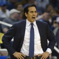 Photo - Miami Heat head coach Erik Spoelstra shouts out instructions during the first half of an NBA basketball game against the Orlando Magic in Orlando, Fla., Monday, March 25, 2013. The Heat won 108-94. (AP Photo/Phelan M. Ebenhack)
