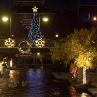 Photo - The Oklahoma City Christmas tree is reflected in the Bricktown canal, Friday, Nov. 28, 2008, in Oklahoma City. PHOTO BY SARAH PHIPPS, THE OKLAHOMAN ORG XMIT: KOD