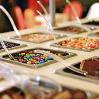 Photo -  The toppings bar is seen at an Orange Leaf Frozen Yogurt store. Photo provided