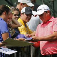 Photo - Jason Dufner signs autographs after on the eighth hole during a practice round for the PGA Championship golf tournament at Valhalla Golf Club on Tuesday, Aug. 5, 2014, in Louisville, Ky. The tournament is set to begin on Thursday. (AP Photo/Mike Groll)