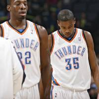 Photo - Oklahoma City's Kevin Durant and Jeff Green walk off the court at the end of the first half of the NBA basketball game between the Oklahoma City Thunder and the Chicago Bulls at the Ford Center on Wednesday, Jan. 27, 2010, in Oklahoma City, Okla.   Photo by Chris Landsberger, The Oklahoman ORG XMIT: KOD