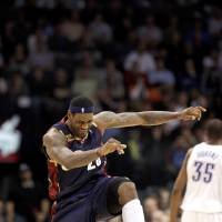 Photo - Cleveland's LeBron James (23) celebrates a basket during the NBA basketball game between the Oklahoma City Thunder and the Cleveland Cavaliers, Sunday, Dec. 13, 2009, at the Ford Center in Oklahoma City. Photo by Sarah Phipps, The Oklahoman ORG XMIT: KOD