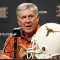 Photo - Texas football coach Mack Brown addresses the media during the Big 12 Conference Football Media Days Monday, July 23, 2013 in Dallas.  (AP Photo/Tim Sharp) ORG XMIT: TXTS104