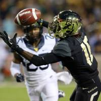 Photo - Baylor wide receiver Tevin Reese (16) pulls down a pass for a touchdown over West Virginia safety Darwin Cook (25) during the first half of an NCAA college football game on Saturday, Oct.  5, 2013, in Waco, Texas. (AP Photo/Jose Yau)