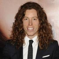 Photo -   FILE - In this file photo taken April 18, 2012, Olympic athlete Shaun White is photographed in New York. A Nashville, Tenn., police report says the two-time Olympic gold medalist snowboarder was charged with vandalism after an employee at a Nashville hotel saw him break a phone there. He is charged with vandalism of $500 or less. (AP Photo/Evan Agostini, File)