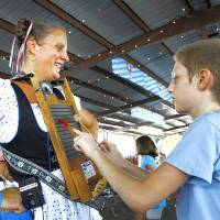 Photo - Valina Witte with the band Das its Lustig has David Vanburkleo play her washboard during Oktoberfest in the Park in Choctaw, Monday, September 3, 2012. Photo By David McDaniel/The Oklahoman