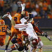 Photo - Oklahoma Sooners quarterback Blake Bell (10) is upended by the UTEP defense during the college football game between the University of Oklahoma Sooners (OU) and the University of Texas El Paso Miners (UTEP) at Sun Bowl Stadium on Saturday, Sept. 1, 2012, in El Paso, Tex.  Photo by Chris Landsberger, The Oklahoman