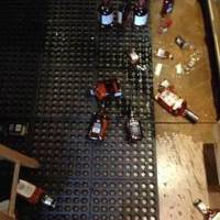 Photo - Broken bottles are on the floor of Edmond Wine Shop in Edmond after 4.5-magnitude earthquake shook the Oklahoma City metro area shortly after noon Saturday.  PHOTO PROVIDED