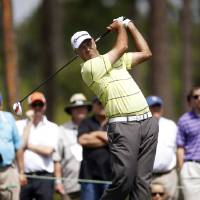 Photo - Stewart Cink tees off on the fourth hole during the second round of the Houston Open golf tournament on Friday, March 29, 2013, in Humble, Texas. (AP Photo/Jon Eilts)