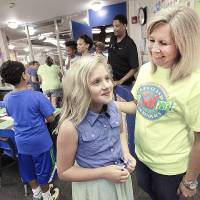 Photo - Fourth-grader Carsen Coggins meets her teacher Janice Campbell during back-to-school night at Cleveland Elementary School in Norman, Monday , August 19, 2013. Photo by David McDaniel, The Oklahoman