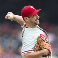 Photo -   Philadelphia Phillies starter Cliff Lee throws a pitch during the first inning of a baseball game against the Washington Nationals in Washington, Wednesday, Oct. 3, 2012. (AP Photo/Manuel Balce Ceneta)