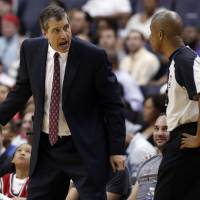 Photo - Washington Wizards coach Randy Wittman discusses a call with referee Sean Corbin during the second half of an NBA basketball game against the Milwaukee Bucks, Saturday, April 12, 2014, in Washington. The Wizards won 104-91. (AP Photo/Alex Brandon)