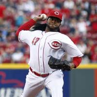 Photo - Cincinnati Reds starting pitcher Johnny Cueto throws against the Milwaukee Brewers during the first inning of a baseball game, Saturday, May 3, 2014, in Cincinnati. (AP Photo/David Kohl)