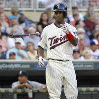 Photo - Minnesota Twins' Danny Santana tosses his bat after striking out against Chicago White Sox starting pitcher Chris Sale during the fifth inning of a baseball game in Minneapolis, Saturday, July 26, 2014. The White Sox won 7-0. (AP Photo/Ann Heisenfelt)