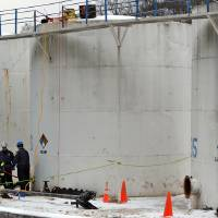 Photo - FILE- In this Jan. 28, 2014 photo, members of the FBI Hazardous Materials Response Unit along with local fire departments investigate the Freedom Industries site on Barlow Drive, in Charleston, W.Va. West Virginia officials want to put the shine back in the state's