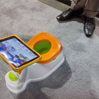 Photo - The iPotty for iPad potty training device is see on display at the Consumer Electronics Show, Wednesday, Jan. 9, 2013, in Las Vegas. No app is available to go with the trainer, but the idea is to keep the child on the toilet for as long as necessary by keeping them digitally entertained. (AP Photo/Julie Jacobson)