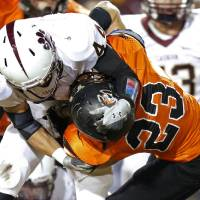 Photo - Cashion's T.J. Martin brings down Crescent's Michael Cronister during a high school football game between Cashion and Crescent in Crescent, Okla., Thursday, Oct. 18, 2012.  Photo by Bryan Terry, The Oklahoman