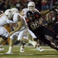 Photo - University of Texas quarterback Colt McCoy is sacked by Texas Tech's Brandon Sesay in the second quarter of an NCAA college football game Saturday, Nov. 1 , 2008, in Lubbock, Texas. (AP Photo/Austin American-Statesman, Jay Janner) ** MAGS OUT, NO SALES, TV OUT, INTERNET: AP MEMBERS ONLY ** ORG XMIT: TXAUS106