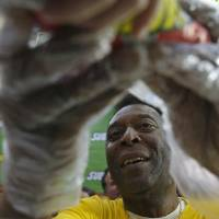 Photo - SUBWAY Global Ambassador and Brazilian soccer legend Pele, serves a sandwich to a lucky customer at a SUBWAY restaurant in Rio de Janeiro, Brazil on Saturday, July 12, 2014.  (Photo by Dado Galdieri/Invision for SUBWAY Restaurants/AP Images)