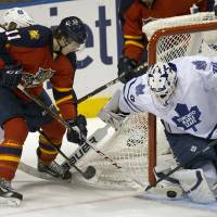 Photo - Toronto Maple Leafs goalie Ben Scrivens blocks a shot on goal by Florida Panthers' Jonathan Huberdeau (11) during the first period of an NHL hockey game in Sunrise, Fla., Monday, Feb. 18, 2013.  (AP Photo/J Pat Carter)