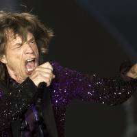 Photo - FILE - In this June 4, 2014 file photo, Rolling Stones singer Mick Jagger performs during a concert in Hayrkon Park in Tel Aviv, Israel. In whatís fast becoming something of a modern World Cup tradition, Brazilians are closely following every team the 70-year-old rock star supports with an eye for mocking the alleged spell he casts on every team he picks. Brazilian media has taken to calling his pick, Jaggerís ìpe frio,î a term describing the bad luck he brings teams that translates literally as ìcold foot.î(AP Photo/Ariel Schalit, File)