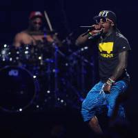 Photo - FILE - In this Sept. 21, 2012 file photo, Lil Wayne performs at the iHeart Radio Music Festival at the MGM Grand Arena in Las Vegas. Lil Wayne and Rick Ross, two of the most celebrated and successful artists in rap today, recently lost major endorsements after protests forced high profile corporations to drop the rap stars. Both artists rapped lyrics deemed vulgar and over-the-top; one referring to rape, the other about the beating of Emmett Till, on songs where they were the featured acts. (Photo by Eric Reed/Invision/AP, File)