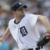 Photo - Detroit Tigers starting pitcher Max Scherzer throws during the first inning of an interleague baseball game against the Pittsburgh Pirates, Thursday, Aug. 14, 2014 in Detroit. (AP Photo/Carlos Osorio)
