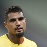 Photo - Ghana's Kevin-Prince Boateng warms up during an official training session the day before the group G World Cup soccer match between Germany and Ghana at the Arena Castelao in Fortaleza, Brazil, Friday, June 20, 2014. (AP Photo/Matthias Schrader)