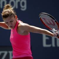 Photo - Simona Halep, of Romania, reacts after a shot against Danielle Rose Collins, of the United States, in the first round during the opening round of the 2014 U.S. Open tennis tournament, Monday, Aug. 25, 2014, in New York. (AP Photo/Elise Amendola)