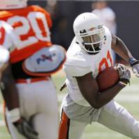 Photo - OSU's Justin Blackmon (81) runs after a catch during the Orange/White spring football game for the Oklahoma State University Cowboys at Boone Pickens Stadium in Stillwater, Okla., Saturday, April 16, 2011. Photo by Nate Billings, The Oklahoman