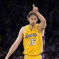 Photo - CELEBRATION: Los Angeles Lakers center Pau Gasol of Spain celebrates a basket during the first half of their NBA basketball game against the Chicago Bulls, Thursday, Nov. 19, 2009, in Los Angeles. (AP Photo/Mark J. Terrill) ORG XMIT: LAS102