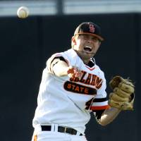 Photo - Oklahoma State pitcher Jon Perin (46) throws the ball to first base to get a runner out during a NCAA college baseball game between Oklahoma State University (OSU) and Arizona State University at Allie P. Reynolds stadium in Stillwater, Okla., Friday, May 2, 2014. Photo by KT King, The Oklahoman