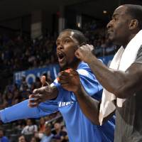 Photo - Oklahoma City's Kevin Durant (35) and Kendrick Perkins (5) react on the bench during the NBA basketball game between the Oklahoma City Thunder and the Sacramento Kings at Chesapeake Energy Arena in Oklahoma City, Tuesday, April 24, 2012. Photo by Sarah Phipps, The Oklahoman.